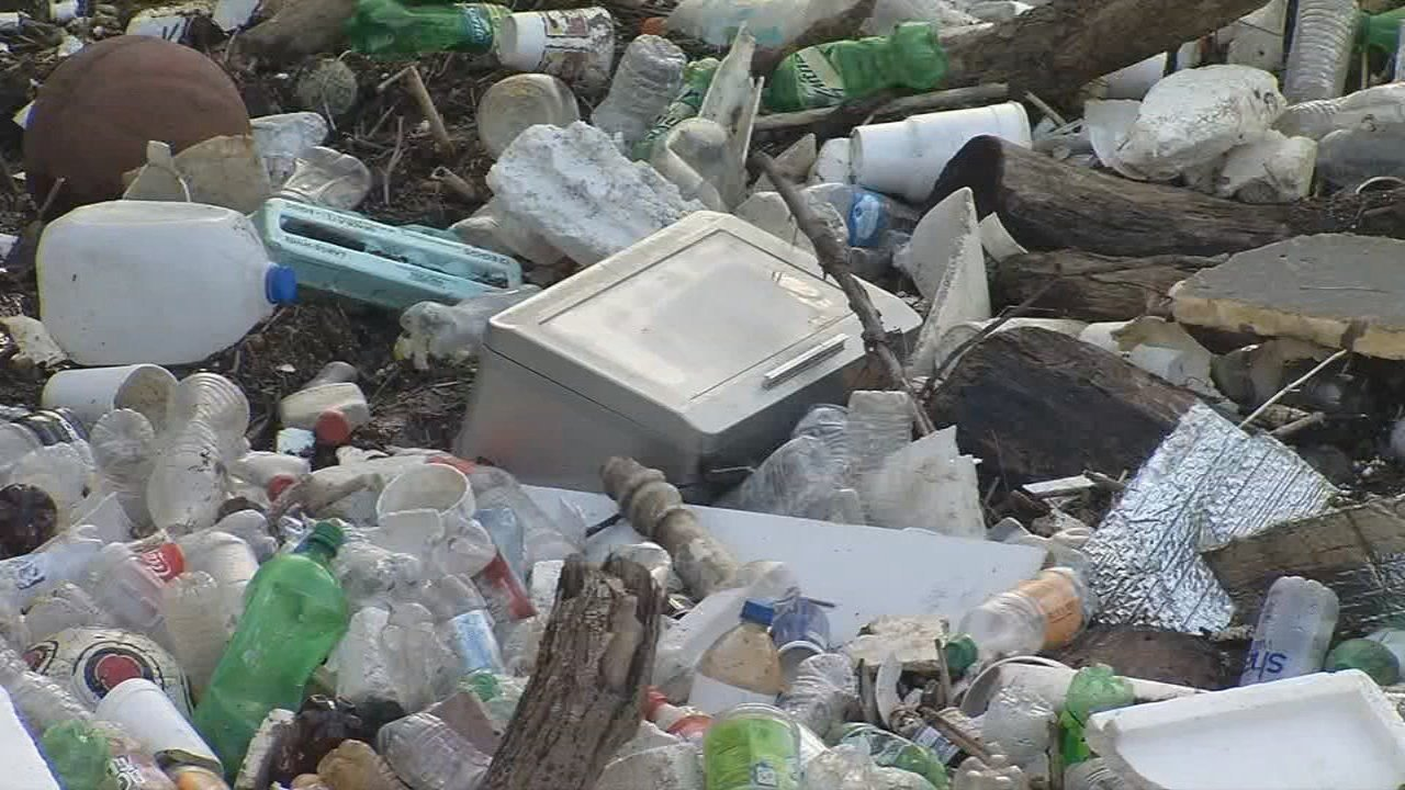 A boom will lift up the trash and put it in dumpsters.