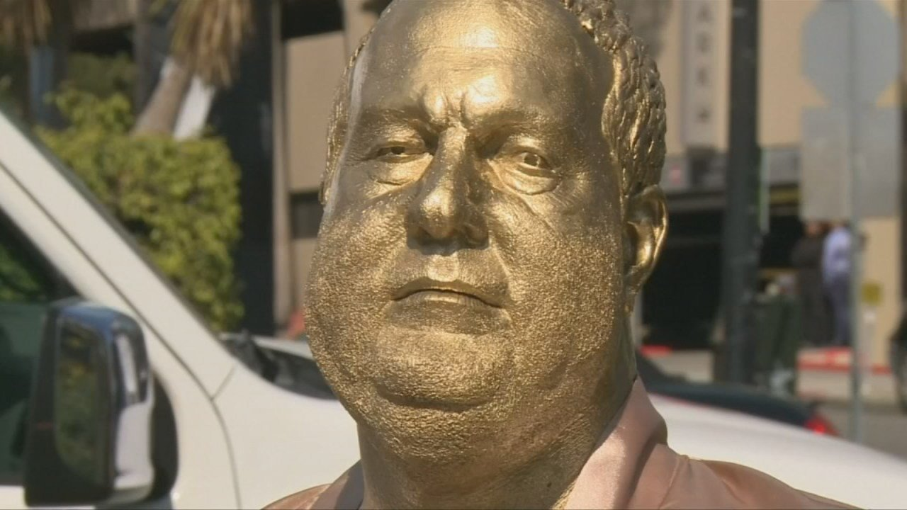 A statue of disgraced Hollywood producer Harvey Weinstein dressed in a bathrobe has been unveiled in Los Angeles.