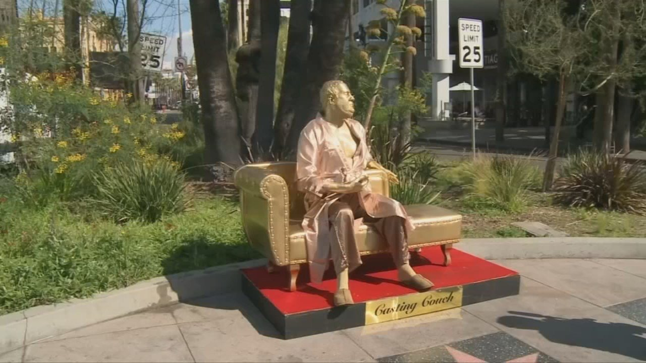 "The statue is being called ""The Casting Couch."" It depicts a life-size Weinstein, clad in a bathrobe, sitting on a golden-colored couch and holding an Oscar statue."