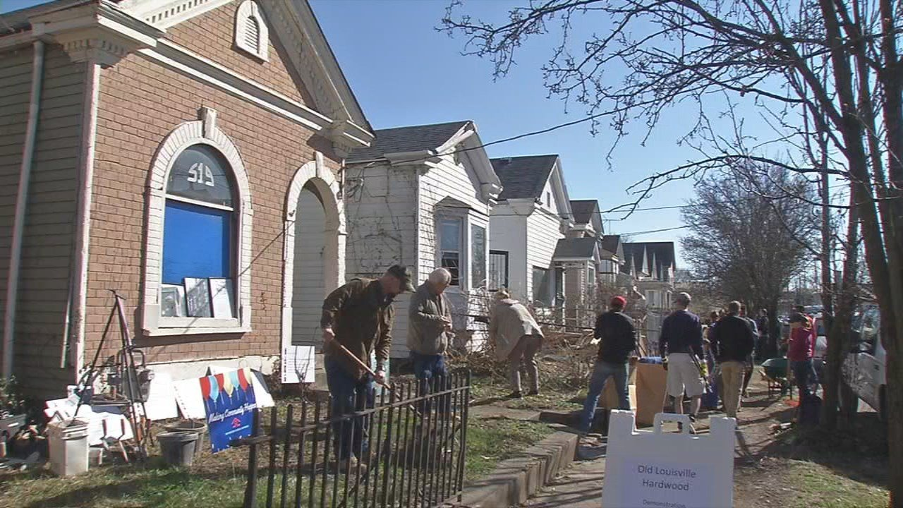 Around 40 volunteers gathered on East Ormsby on Saturday to do yard work at the homes, pick up track, and clean up the sidewalks.
