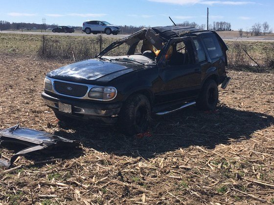 The vehicle spun before leaving the roadway, overturning and rolling into a field where it eventually came to a rest. (Photo provided by Indiana State Police)