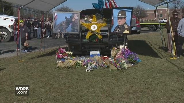 An Indiana sheriff's deputy's car is now a memorial after he was shot and killed in the line of duty.