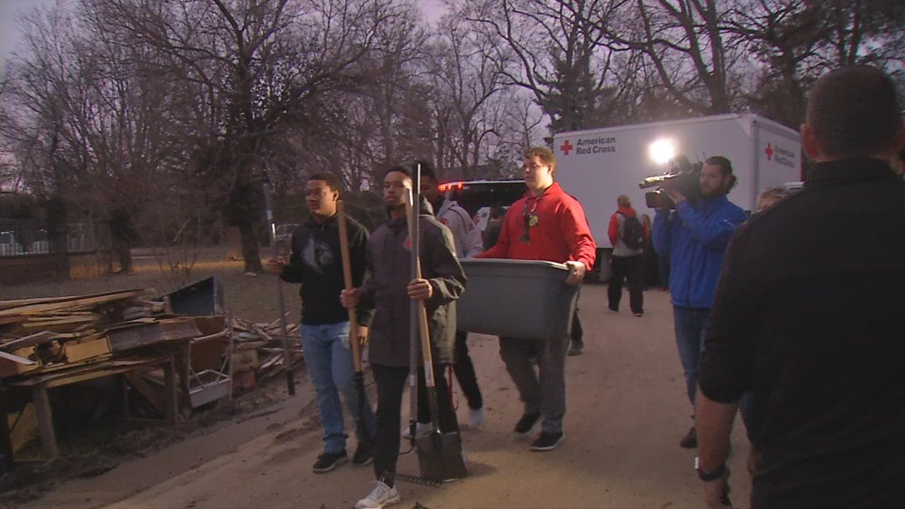 About 40 U of L football players joined members of the Red Cross to help clean up flood debris in Louisville's Riviera neighborhood.