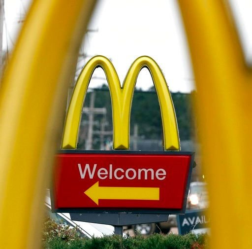 (AP Photo/Rogelio V. Solis, File). FILE- In this Feb. 15, 2018, file photo, shows a sign for a McDonald's restaurant in Brandon, Miss.