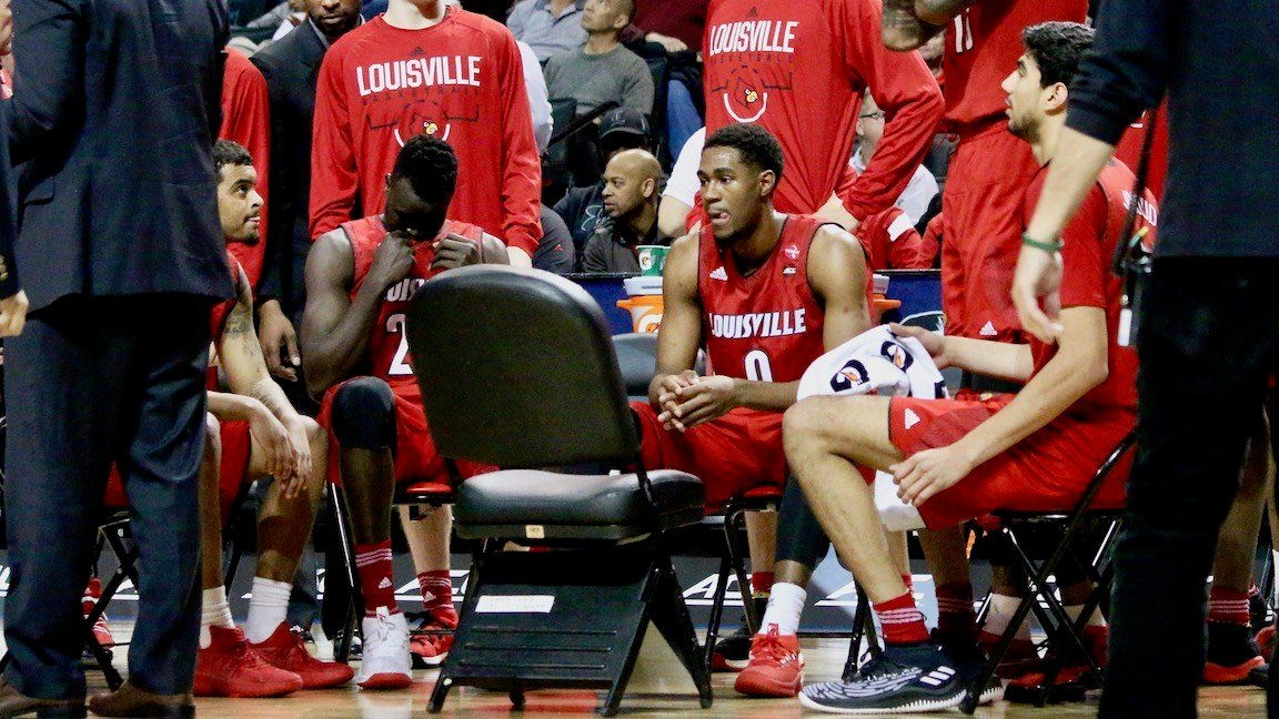 Louisville players wait to talk with interim coach David Padgett before a second half timeout. (WDRB Photo by Eric Crawford)