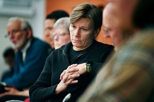 (Angela Wilhelm /The Asheville Citizen-Times via AP). In this Wednesday, March 7, 2018 photo, Asheville Police Chief Tammy Hooper listens to community members as they speak during the Asheville Citizens Police Action Committee meeting.
