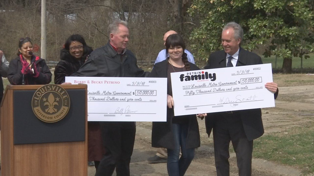 Louisville Mayor Greg Fischer joined U of L head football coach Bobby Petrino and his wife, Becky, to announce $100,000 in funding from the Petrino Family Foundation to help flood victims in Jefferson County.