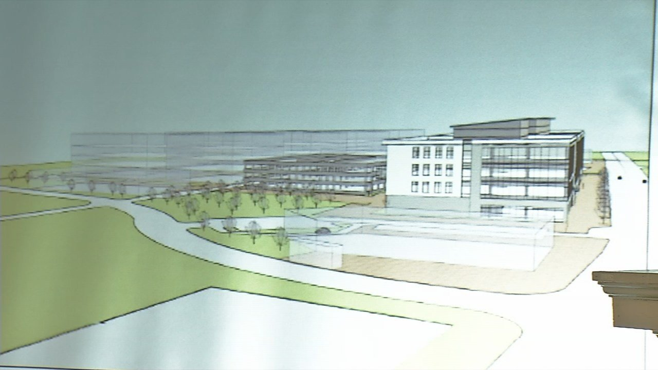 Passport Health released a rendering of the 4-story building that will be its new headquarters.