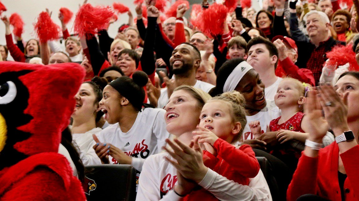 Louisville women's players react to the program's first-ever No. 1 NCAA Tournament seed. (WDRB photo by Eric Crawford)