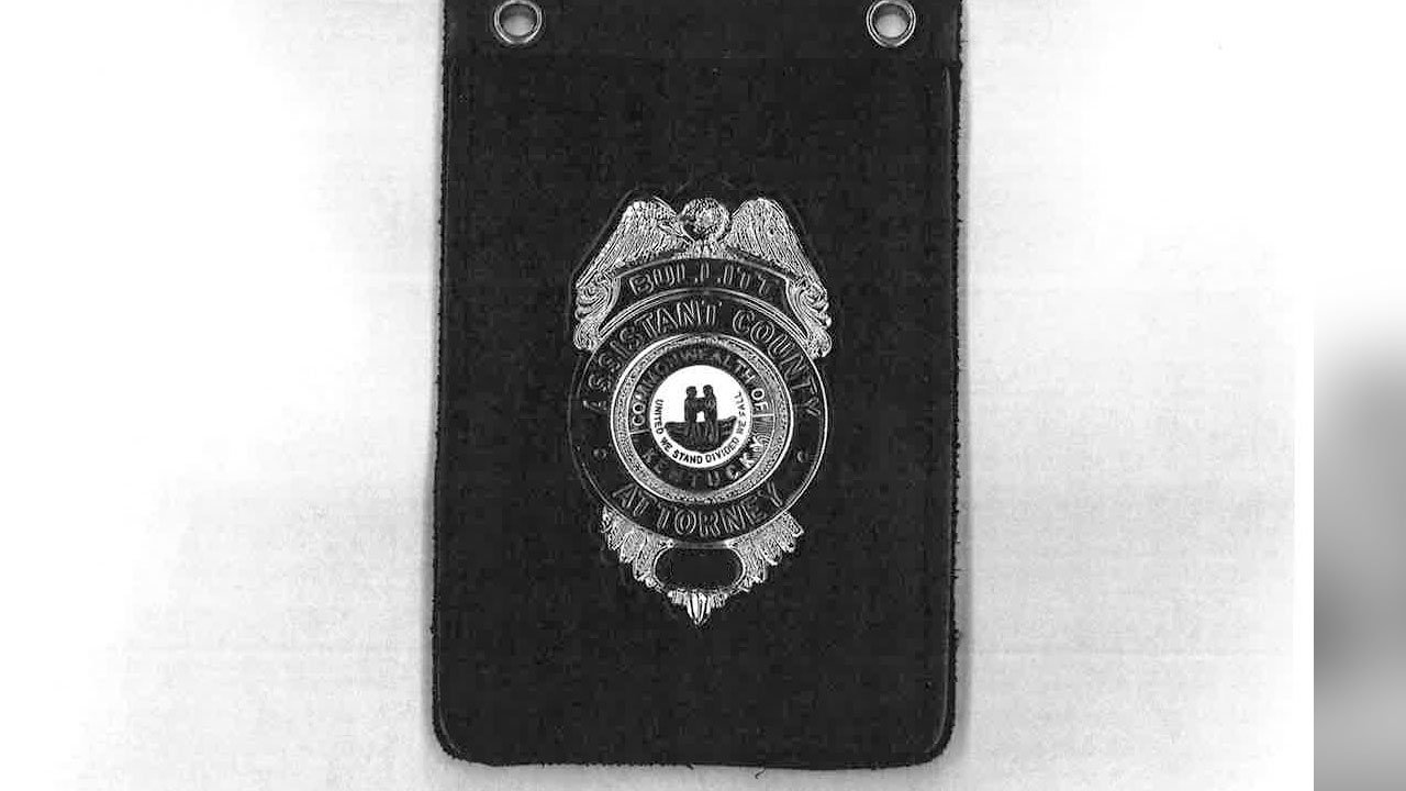 Doug McCann said that two people took his metal county attorney badge, similar to this one.