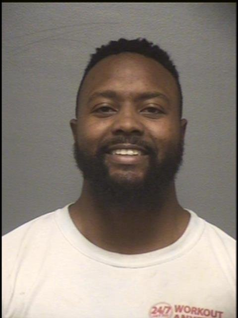 Detective William Garrett was arrested on Tuesday and charged with domestic assault, unlawful imprisonment, and intimidating a participant in a legal process.(Louisville Metro Corrections)