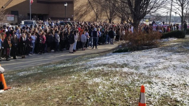 Hundreds of students from duPont Manual in Jefferson County on March 14, 2018 to protest gun violence and honor the victims of recent school shootings.