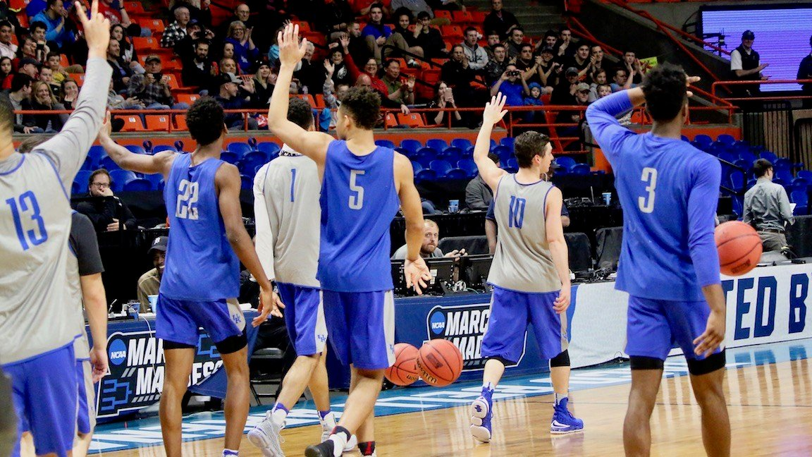 Kentucky players wave to fans after their shootaround (WDRB photo by Eric Crawford)