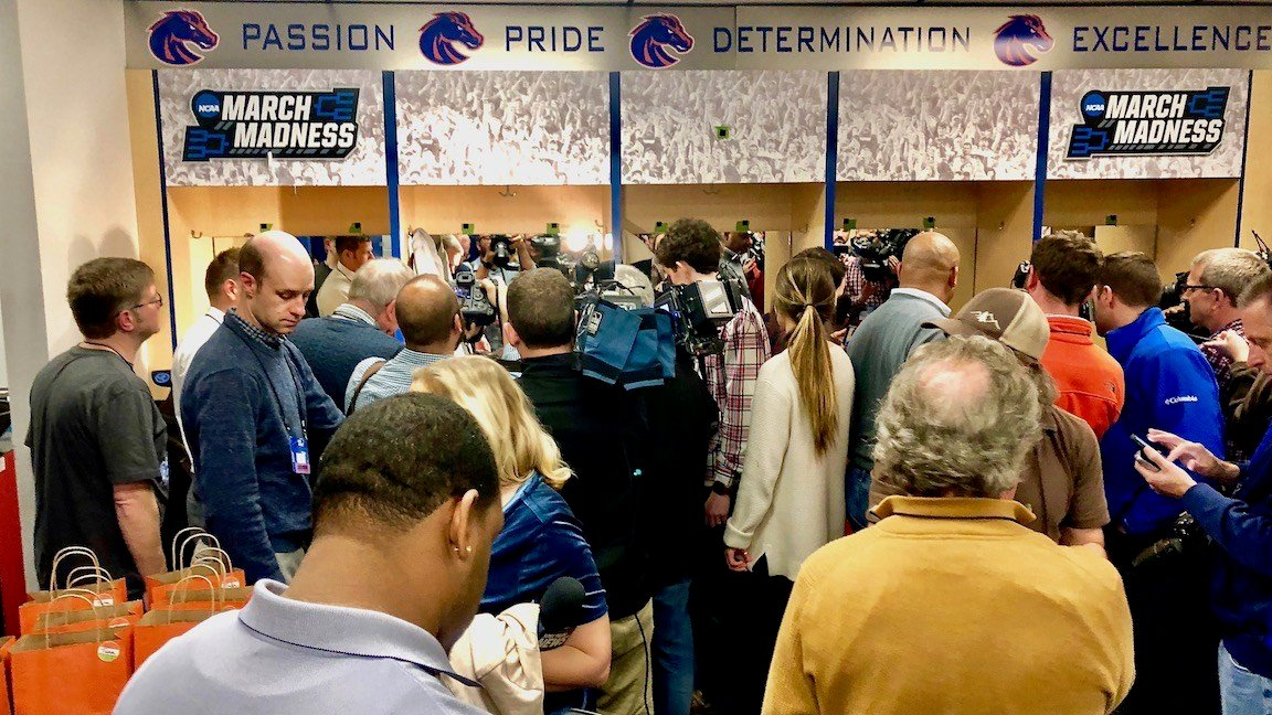 Reporters crowd into the Kentucky locker room in Boise, Idaho. (WDRB photo by Eric Crawford)