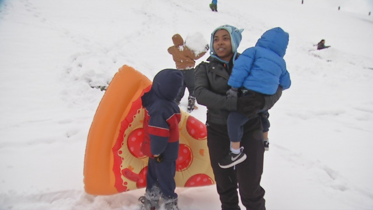 Sledding on a snow day with a pizza sled is the ultimate way to go down a hill.