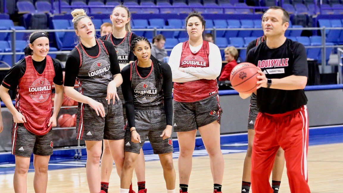 Louisville players watch as Jeff Walz attempts an eyes-closed free throw during Thursday's NCAA shootaround in Rupp Arena. (WDRB photo by Eric Crawford)