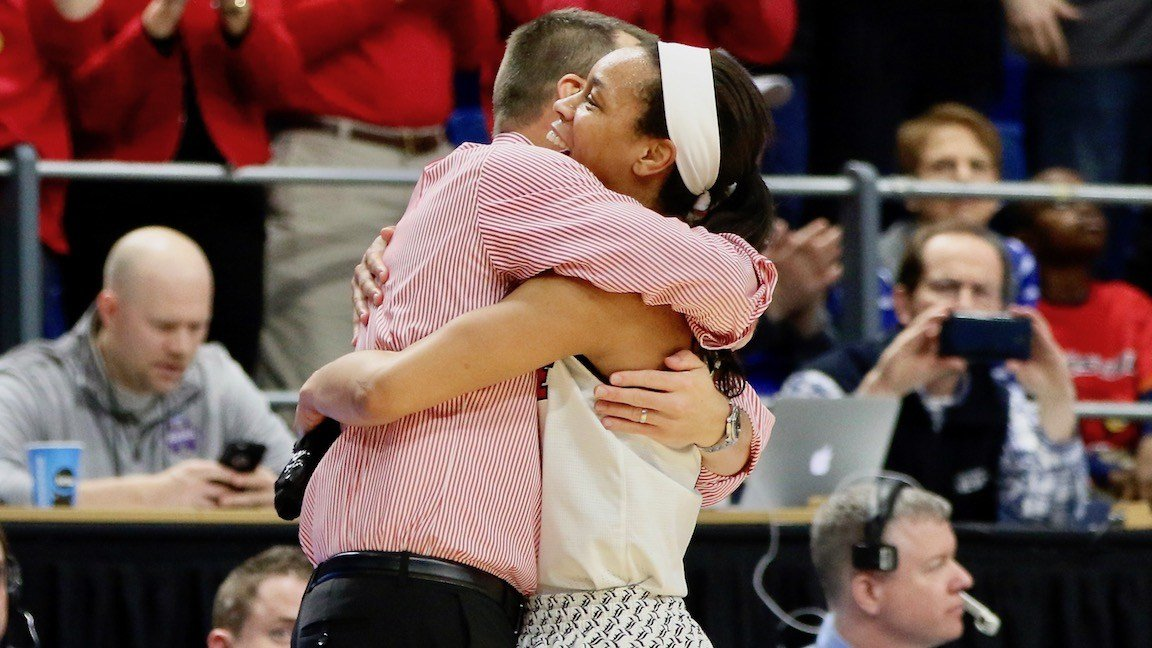 Louisville coach Jeff Walz hugs Asia Durr as she leaves the game in Louisville's regional final win over Oregon State. (WDRB photo by Cindy Rice Shelton)