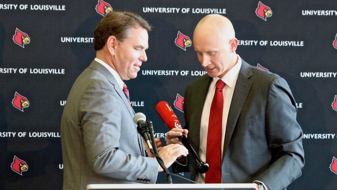 Vince Tyra introduces Chris Mack. (WDRB photo by Eric Crawford)