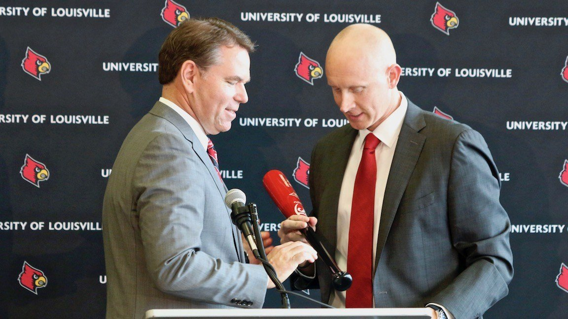 Louisville athletics director Vince Tyra with Chris Mack. (WDRB photo by Eric Crawford)