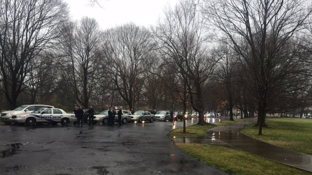 Police and community members joined a procession at Cave Hill Cemetery on March 29, 2018 to honor the life of fallen Officer Nick Rodman.
