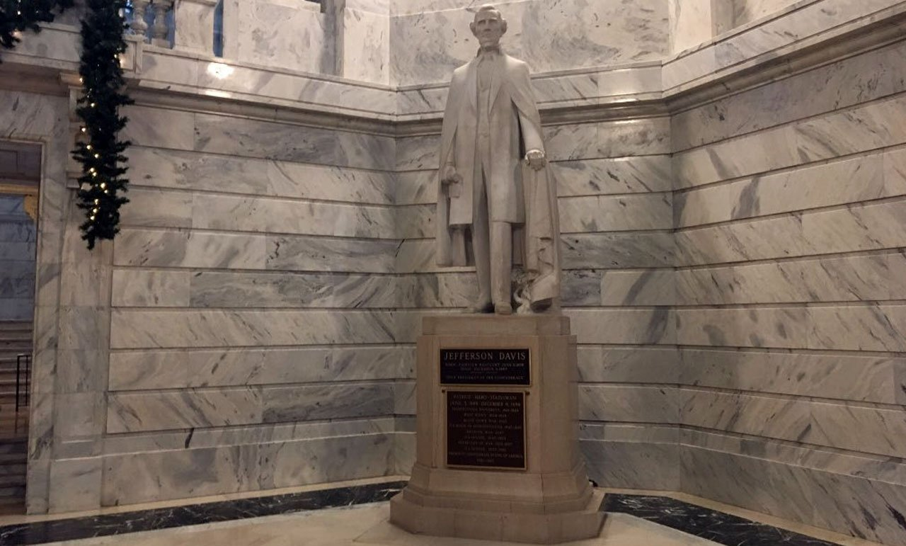 """Officials in Kentucky have removed a plaque from a Jefferson Davis statue in the state Capitol declaring the only president of the Confederacy to be a, """"patriot, hero, statesman."""""""
