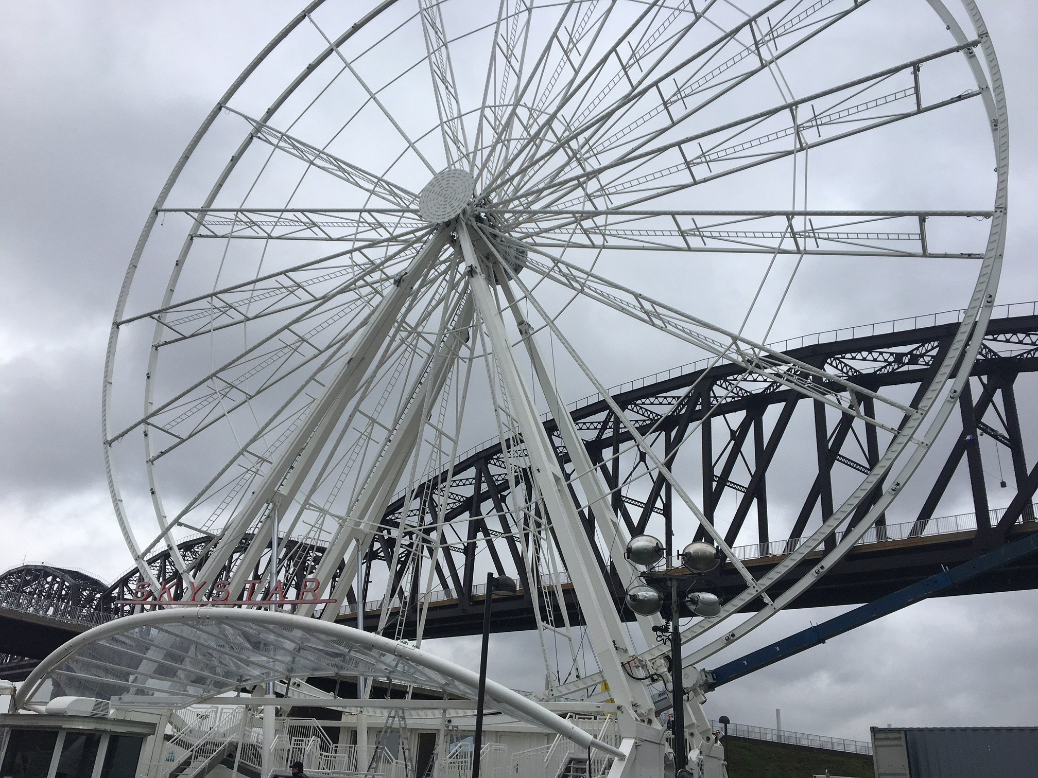 The opening of the SkyStar Observation Wheel is being delayed because of rain and wet weather.
