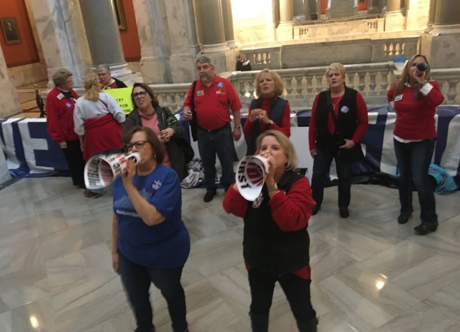 Teachers protested outside the House chamber as legislators discussed the pension reform bill.