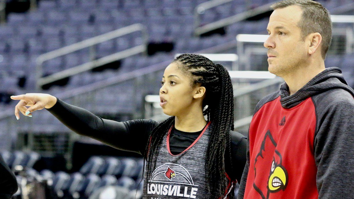 Arica Carter makes a point with coach Jeff Walz during Louisville's last full workout before facing Mississippi State in the Final Four. (WDRB photo by Eric Crawford)