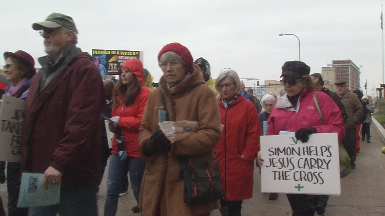 """They gathered for the 22nd annual """"Way of the Cross: A Walk For Justice."""" The event is held on Good Friday every year."""