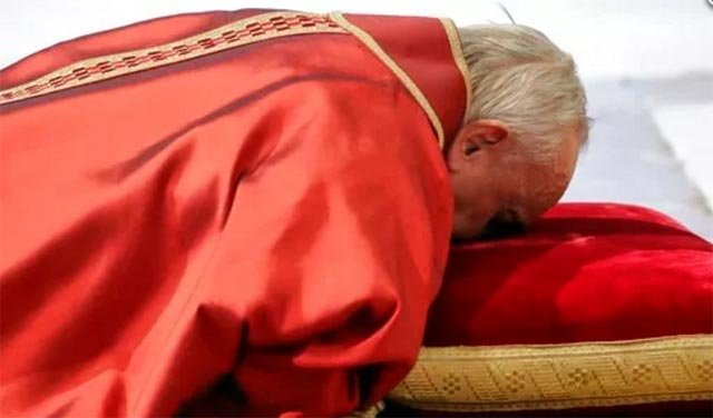 (AP Photo/Andrew Medichini). Pope Francis lies down in prayer during the Good Friday Passion of Christ Mass inside St. Peter's Basilica, at the Vatican, Friday, March 30, 2018.