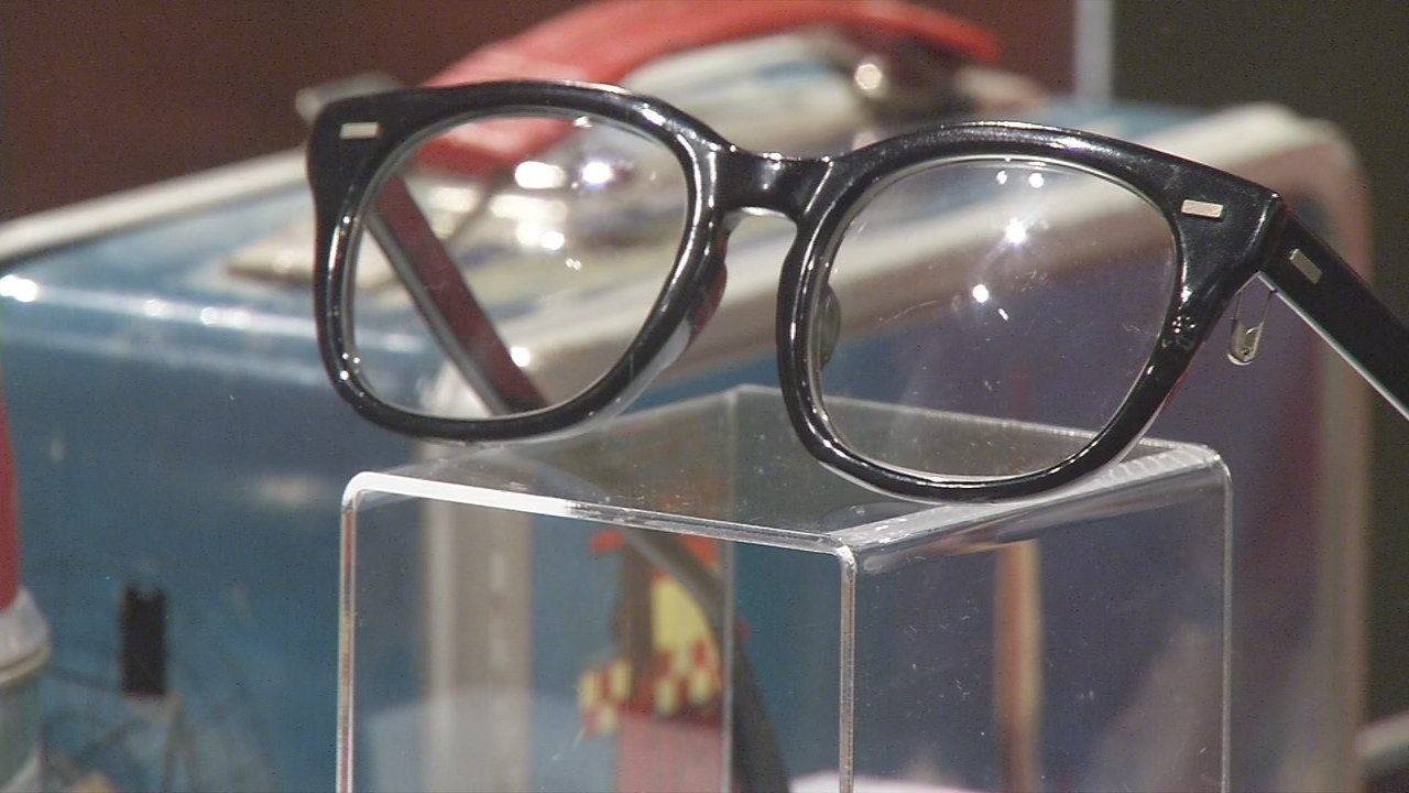 The exhibit is packed with original props from the movie, including Squints' glasses and the famous Babe Ruth baseball.