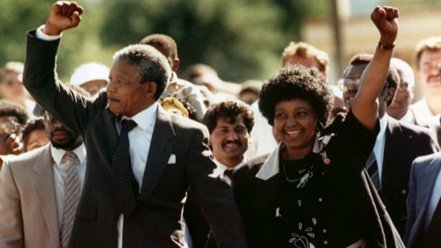 FILE - In this file photo dated Sunday, February 11, 1990, Nelson Mandela and wife Winnie, walk hand in hand, raising their clenched fists upon his release from Victor prison, Cape Town, 27 years in detention.