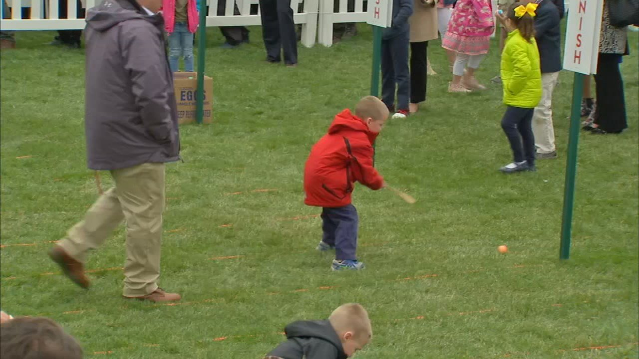 Thousands of children packed the lawn to roll Easter eggs.
