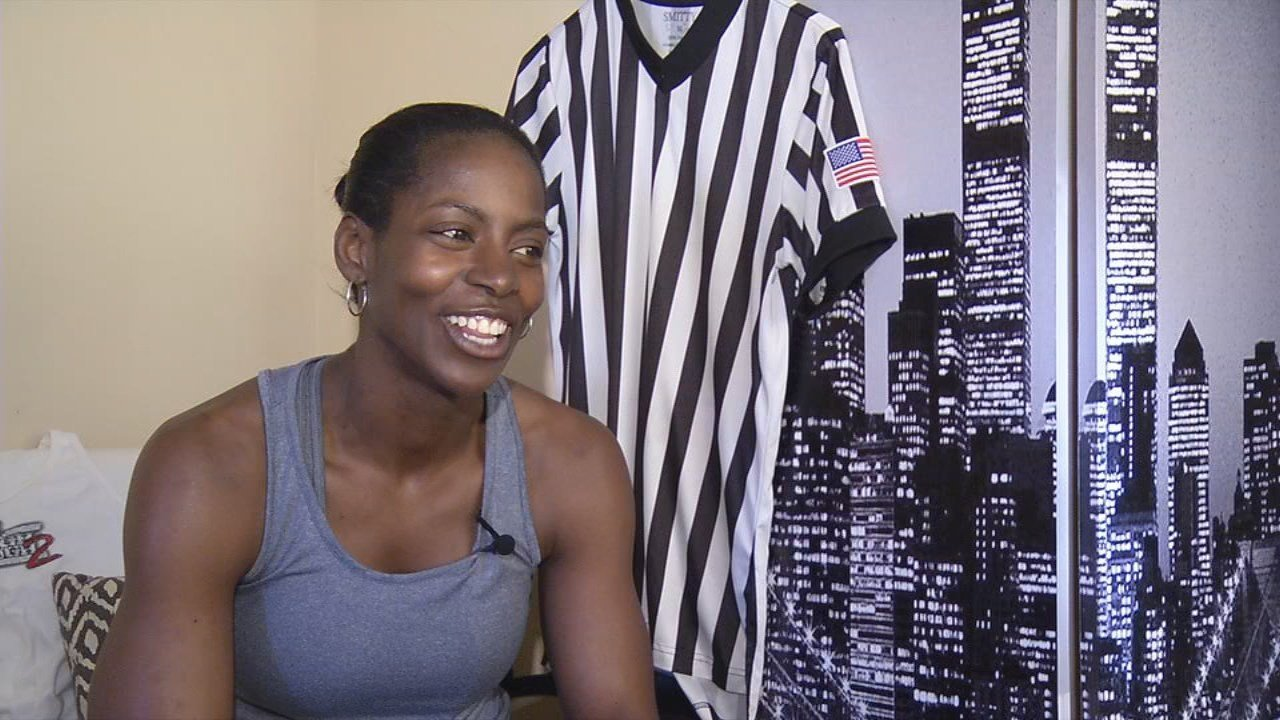 Former wrestler Lisa Miles is now a college basketball referee.