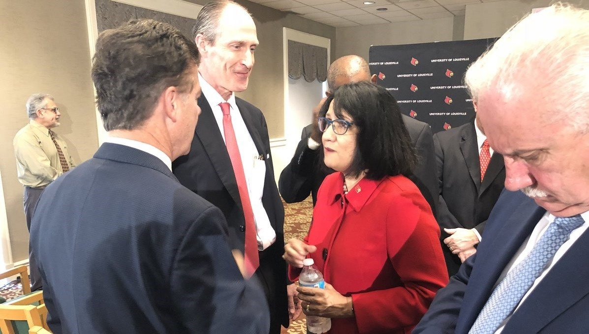 Neeli Bendapudi talks with GLI's Kent Oyler and U of L Trustee Brian Cromer after being introduced as U of L's next president.