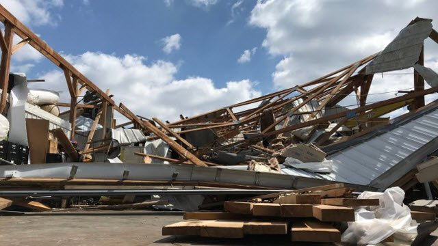 A garage/storage area was flattened by straight-line winds in Sonora, Kentucky during severe weather on April 3, 2018.