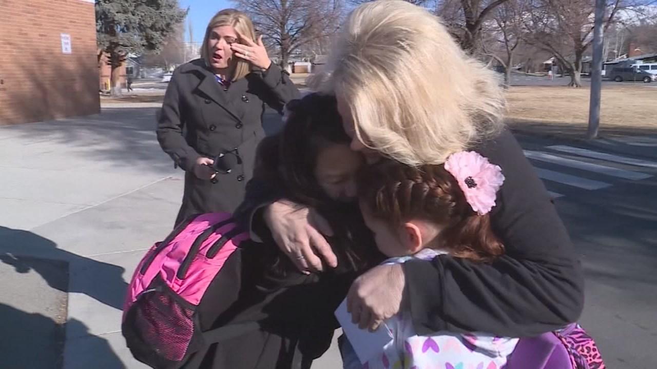 Isabella Pieri hugs bus driver Tracey Dean, who braids her hair each morning before school.