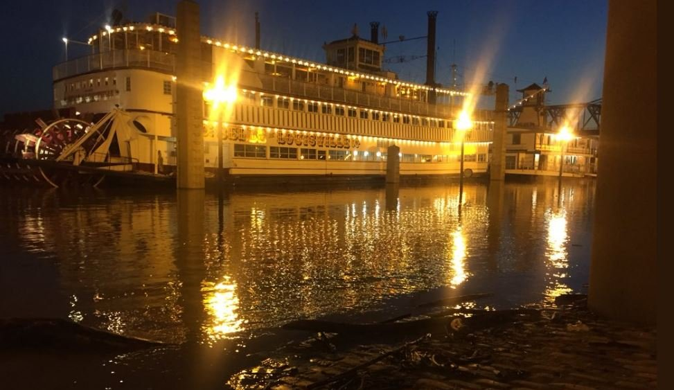 The Belle of Louisville was surrounded by flood water and debris as rising waters swallowed up the parking lot.