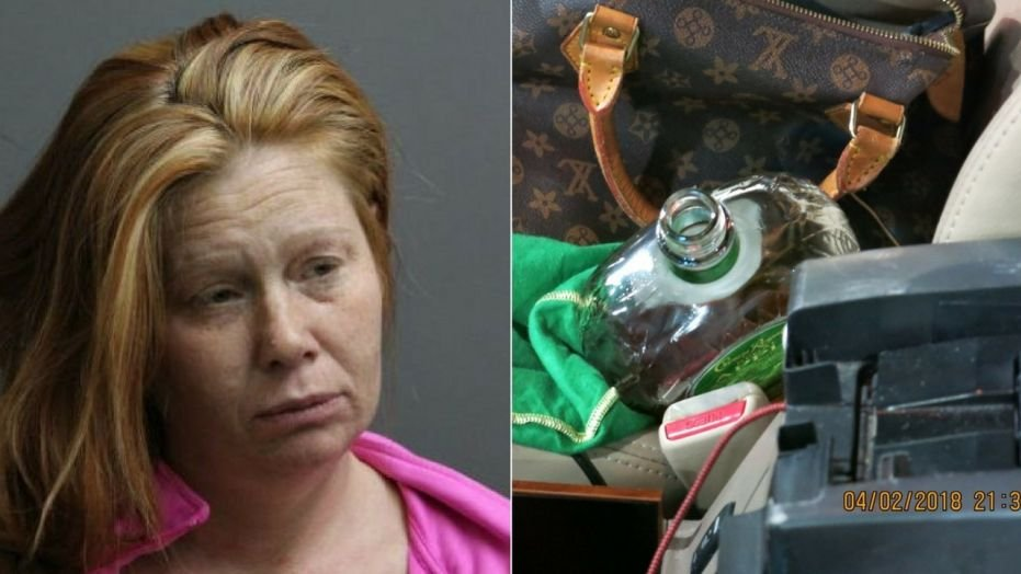 An open bottle of Crown Royal Liquor was found in the passenger seat of Tasha Schleicher's car. (Riverside Police Department via FOX News)