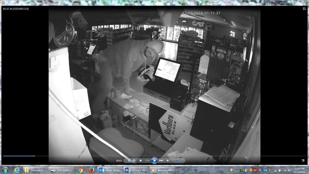 This video surveillance image shows a man jumping over a counter at Paul's Food Mart during a break-in on March 12, 2018.