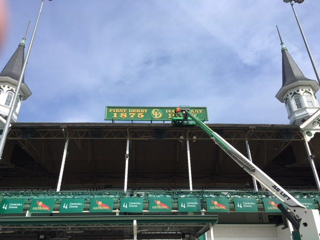 Crews at Churchill Downs updated Derby signage at the track.