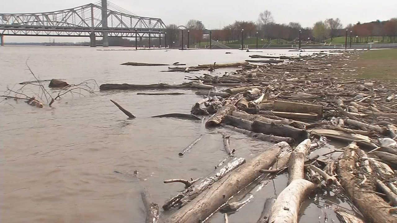 Flooding and debris continued to plague downtown Louisville Friday afternoon.