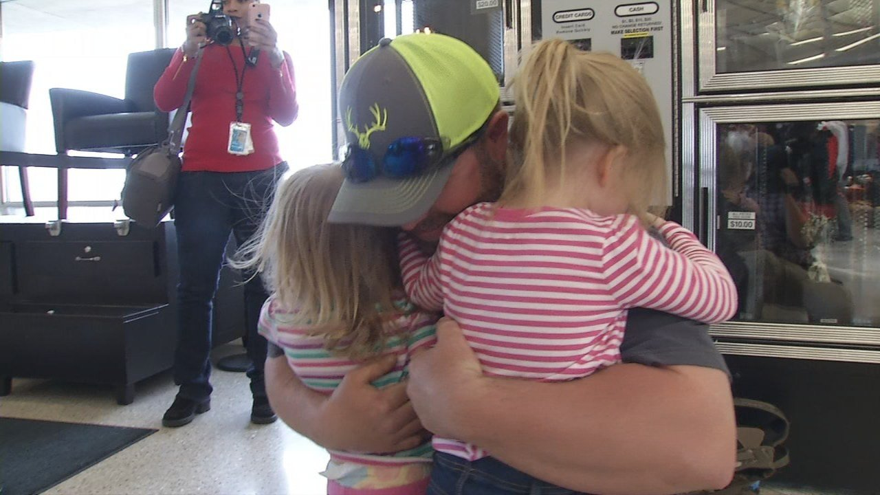 LG&E and KU workers were welcomed home by family and friends, after a month in Puerto Rico helping restore power.