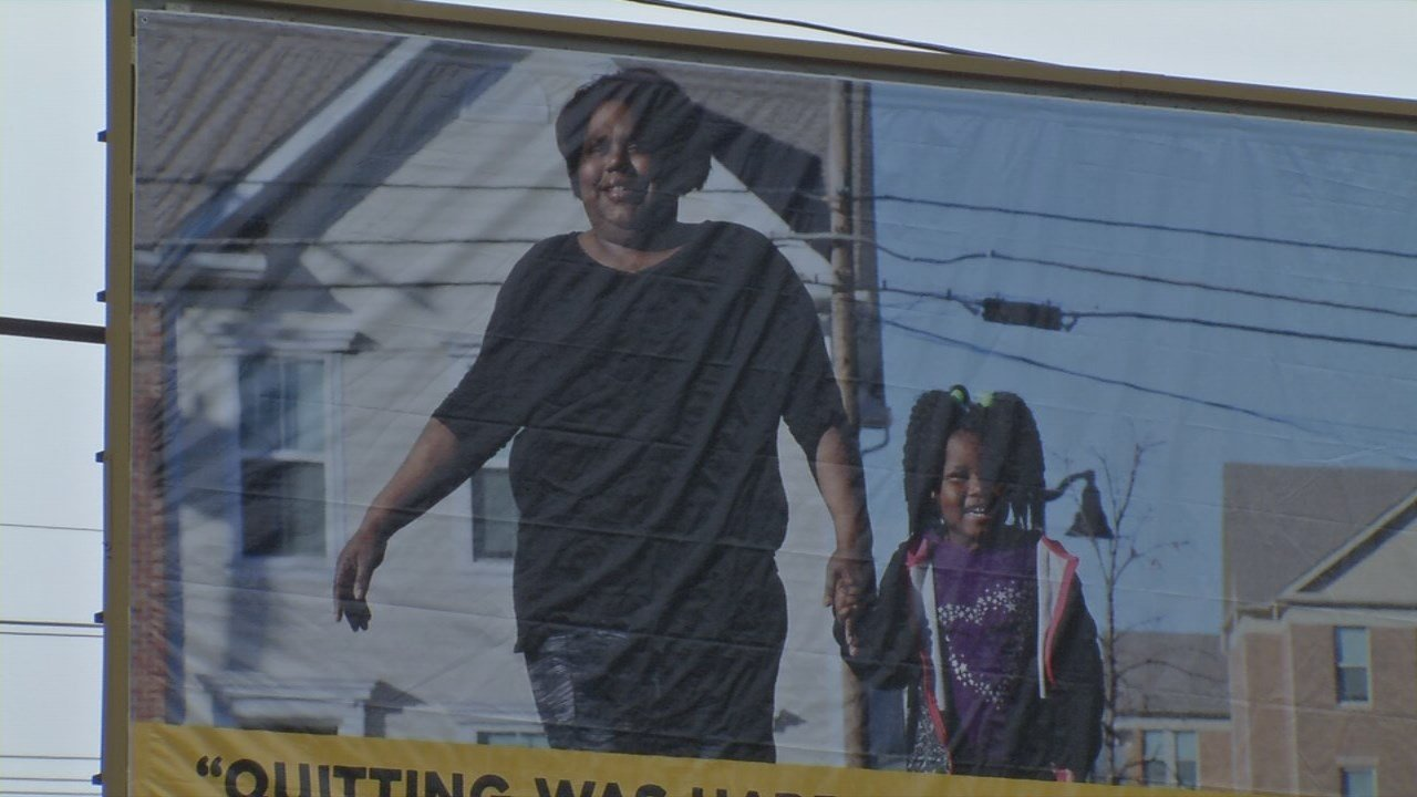 The story of Clevetta Thomas and her daughter shines down near the intersection of Kentucky and Shelby Streets for all in Smoketown to see.