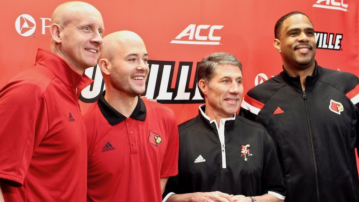 Louisville coach Chris Mack with assistants Luke Murray, Dino Gaudio and Mike Pegues. (WDRB photo by Eric Crawford)