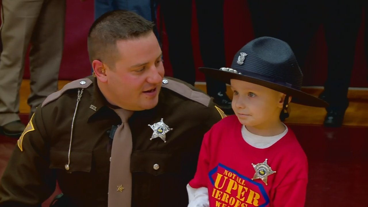 Brantley Taber, who is battling cancer, was all smiles after becoming an honorary sheriff's deputy.