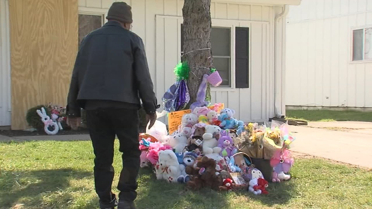 A growing memorial in Indianapolis outside the home where 1 year-old Malaysia Robson.