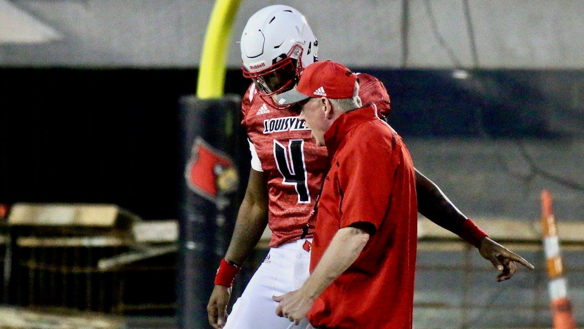 Louisville coach Bobby Petrino makes a point to sophomore quarterback Jawon Pass at the end of the first half. (WDRB photo by Eric Crawford)