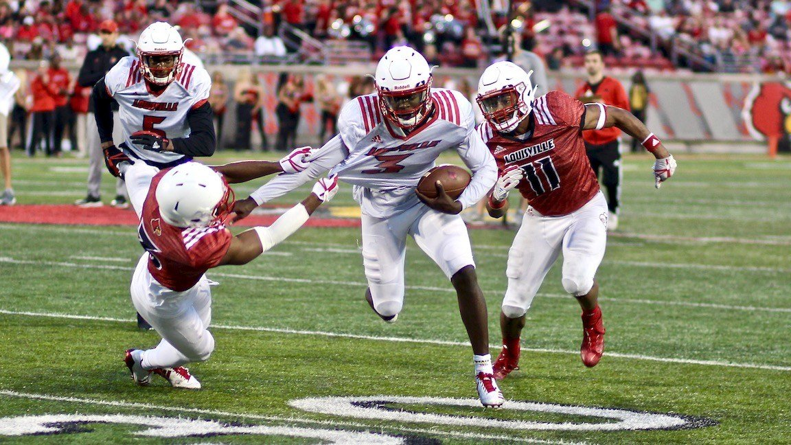 Redshirt freshman quarterback Malik Cunningham breaks a tackle in the second quarter. (WDRB photo by Eric Crawford)