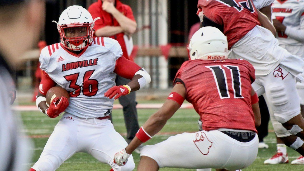 Redshirt freshman running back Maurice Burkley tries to shake a defender. (WDRB photo by Eric Crawford)